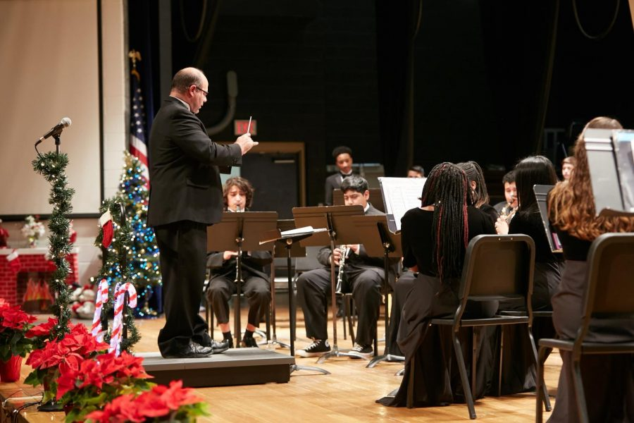 Band director, Michael Basham conducts the band in their holiday concert