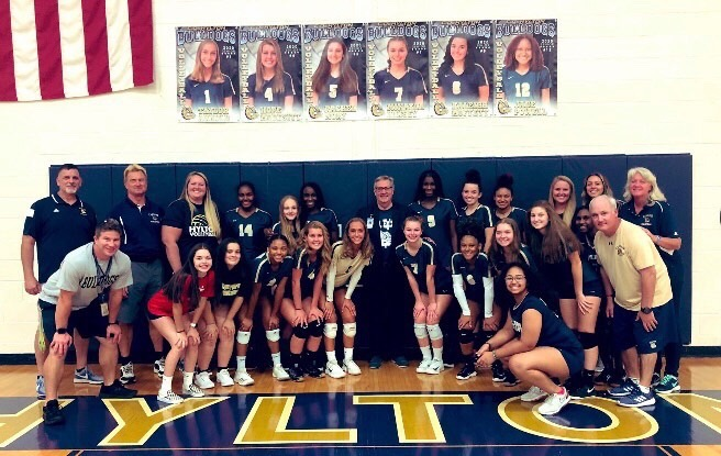 The+Varsity+Volleyball+team+in+Hylton%27s+gym.