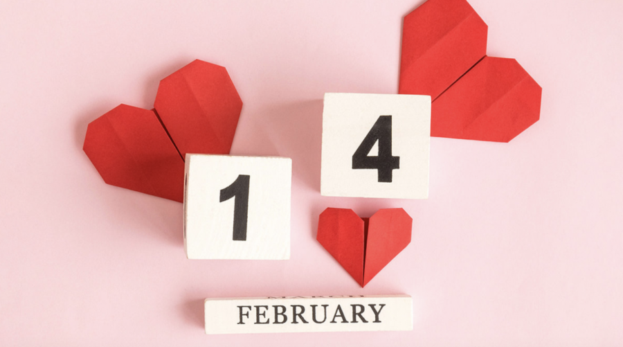 Celebrate Valentine's day with 14 fun activities! Pictured above: blocks of wood, paper hearts, and pink background.