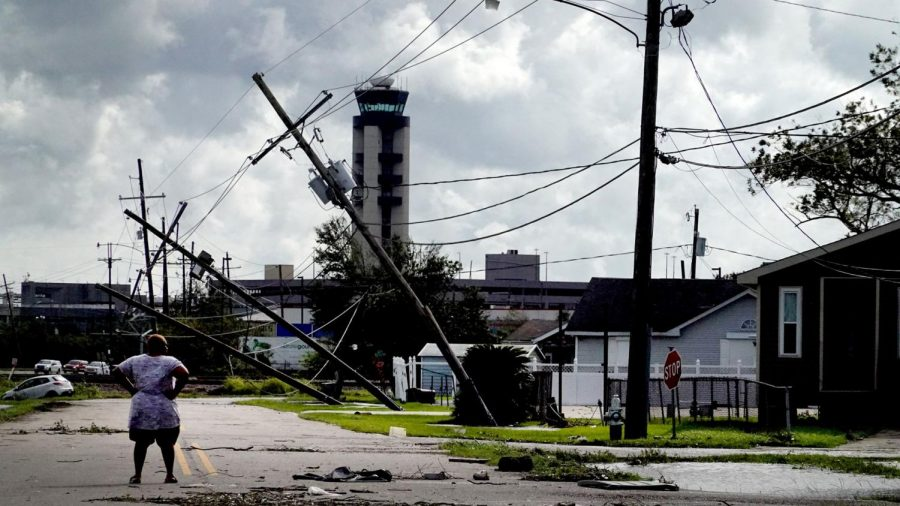 A person looking over damage caused by Hurricane Ida in Kenner, La., on Aug. 30